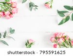Stock photo flowers composition frame made of eucalyptus branches and pink rose flowers on white wooden 795591625