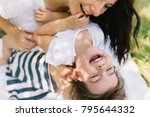 cropped shot cute happy kid... | Shutterstock . vector #795644332