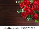 Red Roses Bouquet Placed On A...