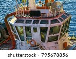 Small photo of Wheelhouse marine tug all-round visibility, vessel towing, tow-out . Port Of Murmansk