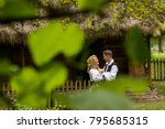 romanian couple wearing... | Shutterstock . vector #795685315