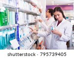 smiling young pharmacist and... | Shutterstock . vector #795739405