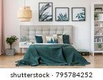 rattan lamp above bed with... | Shutterstock . vector #795784252
