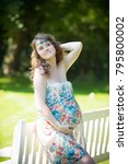 beautiful young pregnant woman   Shutterstock . vector #795800002