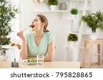 Young Beautiful Woman Eating...
