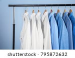clean shirts hanging on rack in ... | Shutterstock . vector #795872632
