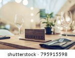 reserved sign on table in... | Shutterstock . vector #795915598