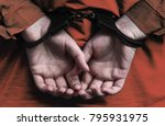 Small photo of Hands of the girl in handcuffs. arrest. a crime. law. execution of sentences
