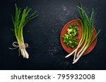 fresh green onion on a wooden...