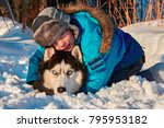 Child With A Husky Dog In A...