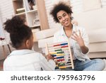mom and daughter are engaged in ... | Shutterstock . vector #795963796