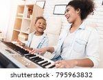 mom teaches a little girl to... | Shutterstock . vector #795963832