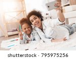 mom and little girl lie on the... | Shutterstock . vector #795975256