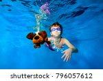 happy little girl swims... | Shutterstock . vector #796057612