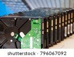 pile of hard drives on blue... | Shutterstock . vector #796067092
