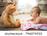 Baby Looking At Stuffed Animal...