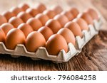 chicken eggs in carton box on... | Shutterstock . vector #796084258