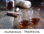 glass of rum on a rustic wooden ... | Shutterstock . vector #796093156