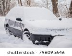 Small photo of car covered stuck in a snow after a heavy snow fall