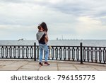 a guy turns a girl in a hug on... | Shutterstock . vector #796155775