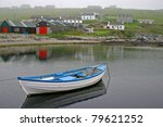 Small Boat On A Misty Day Near...