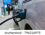 grey car at gas station being... | Shutterstock . vector #796216975