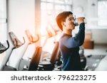 fitness man drinking protein... | Shutterstock . vector #796223275
