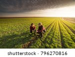 young farmers examing planted... | Shutterstock . vector #796270816