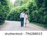 young man and woman walking in... | Shutterstock . vector #796288015
