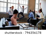 business team jump for joy at... | Shutterstock . vector #796356178