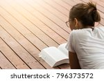 young woman reading a book at... | Shutterstock . vector #796373572