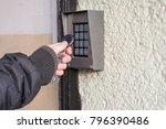man open the safety door with... | Shutterstock . vector #796390486
