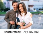 young couple in love posing on... | Shutterstock . vector #796402402