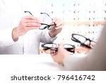 optician and customer choosing...   Shutterstock . vector #796416742