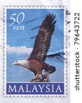 Small photo of MALAYSIA - CIRCA 1997: A 50-sen aerogram stamp printed in Malaysia shows an eagle preparing to take off in flight, circa 1997