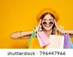 beautiful woman with shopping  ...   Shutterstock . vector #796447966
