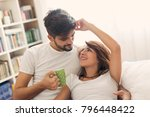 loving couple cuddling and... | Shutterstock . vector #796448422