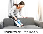 young family uses a vacuum... | Shutterstock . vector #796466572