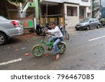 an indian child playing in...   Shutterstock . vector #796467085