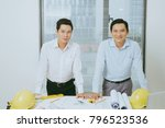 architects engineer discussing... | Shutterstock . vector #796523536