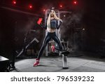 in the gym after a heavy... | Shutterstock . vector #796539232