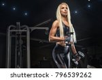 a girl in a weight lifting gym... | Shutterstock . vector #796539262