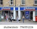 Small photo of HUDDERSFIELD, UK - JULY 10, 2016: People walk by Nationwide Building Society branch in Huddersfield, UK. NBS is the largest building society in the world. It had 495.3 m GBP annual income in 2009.
