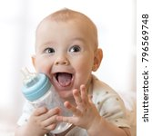 sweet little baby boy holding... | Shutterstock . vector #796569748