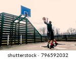 young basketball player... | Shutterstock . vector #796592032