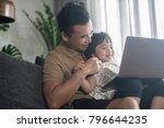 happy asian father and daughter ... | Shutterstock . vector #796644235