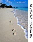 Footprints In The Sand As Wate...