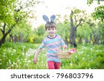 cheerful kid holding basket... | Shutterstock . vector #796803796