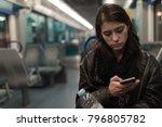 sad depressive woman in train... | Shutterstock . vector #796805782