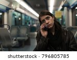 sad depressive woman in train... | Shutterstock . vector #796805785